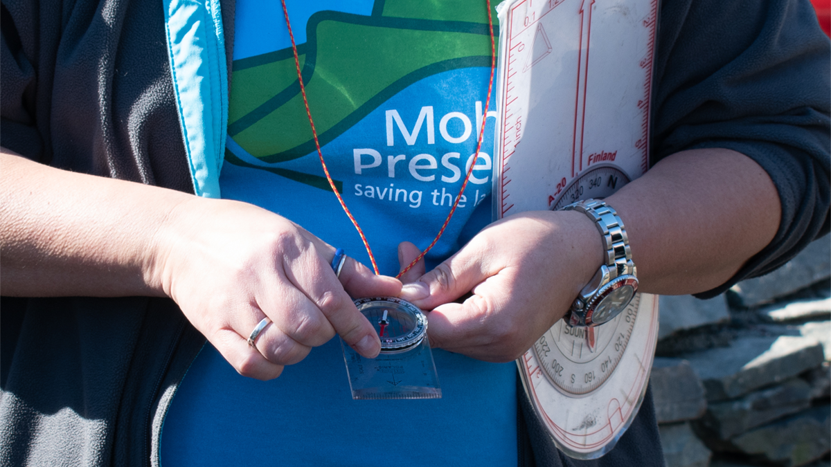 Mohonk Preserve Education staff hold a compass
